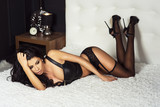 Fototapety Sexy brunette woman in bed