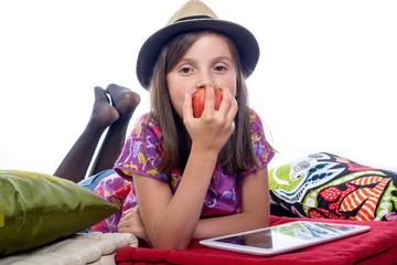 girl with a digital tablet and an apple in his hand
