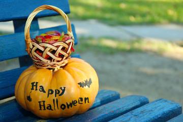 Halloween pumpkin and basket with candies
