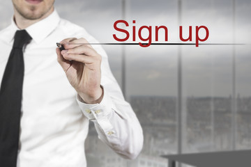 businessman writing in the air sign up