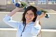 Goofy girl with skateboard