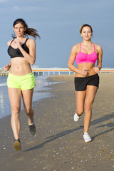 Women jogging on a beach