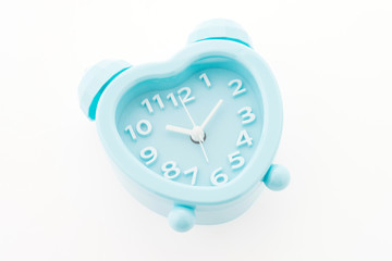 blue alarm clock isolated on white background
