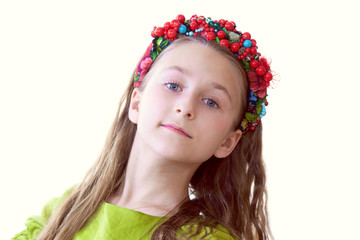Lovely little dancer posing with wreath, close-up