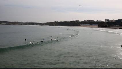 Surfers on Towan beach Newquay North Cornwall England UK