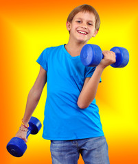 isolated portrait of smiling kid exercising with dumbbells