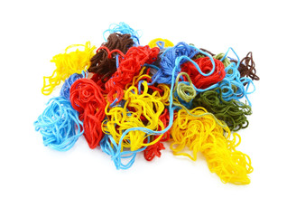 Multi-coloured embroidery threads in a tangled heap