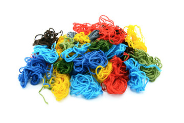 Assorted colourful embroidery threads in a heap