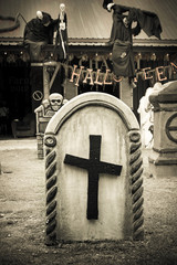 Tombstone and grave in graveyard, Halloween