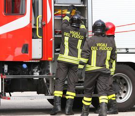 firefighters working near the fire truck when handling an emerge