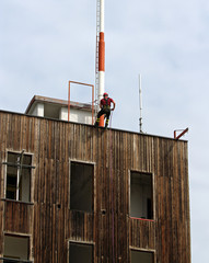 fireman climbing expert during the ascent abseiling from a build