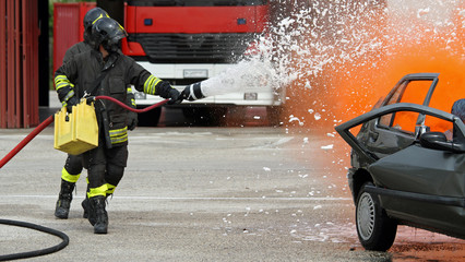 Firefighter with helmet off the car during a practice session