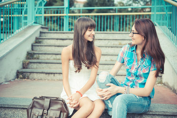 beautiful hipster young women sisters friends