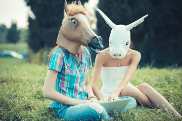 mask horse and rabbit women sisters friends using smartphone and
