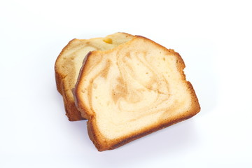Caramel and sweet fruit pound cake on white background