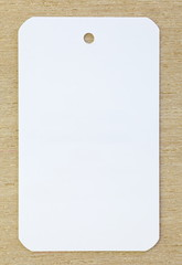 white blank paper tag price on wood table