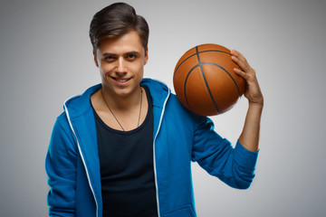 Portrait of a young man basketball player