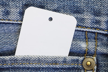 white blank paper tag price on blue jean