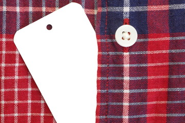 white blank paper tag price on check shirt