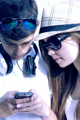 young couple in communicating with mobile phone