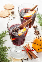 Mulled wine with orange slices on white - winter warming drink