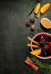 Mulled wine with orange slices on chalkboard - warming drink