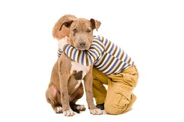 Portrait of a boy hugging a puppy pitbull