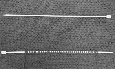 trico noir et blanc deux aiguilles