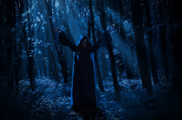 Witch in night forest