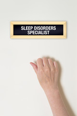 Female hand is knocking on Sleep Disorder specialist door