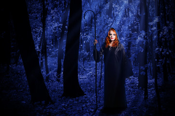 Witch in the moonlight forest