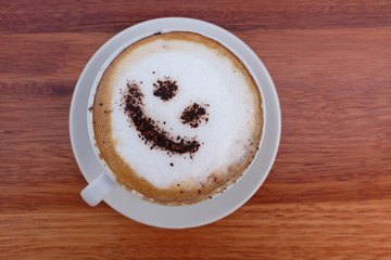 Coffee cappuccino foam or chocolate smiling happy face