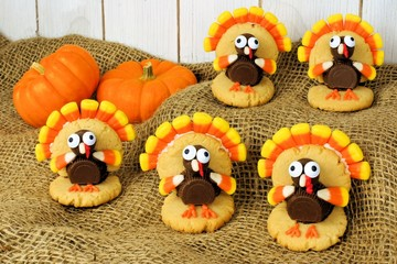 Thanksgiving turkey shaped cookies on burlap with pumpkins