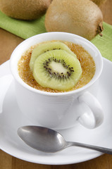 creme brulee with kiwi in a cup