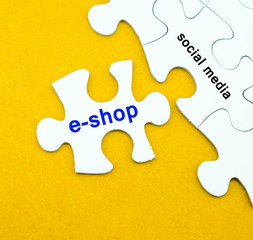 Jigsaw puzzle with e-shop and social media word