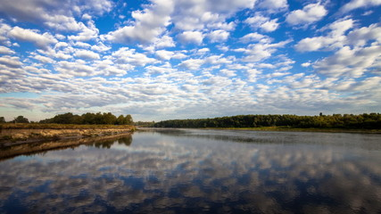 Beautiful clouds reflected in the river.