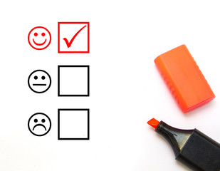 Check mark with red marker on customer service evaluation form