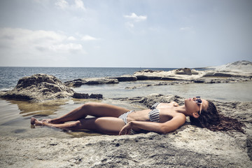 Girl lying at the beach