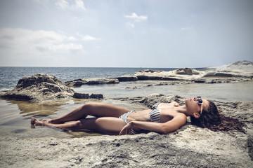 Girl lying at the beach