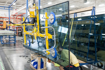 Glazier working on glass