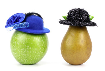 apple and pear in a hat