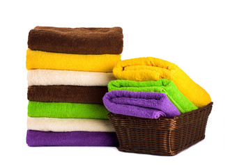 Stack of clean fresh towels isolated on white background