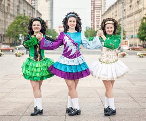 Three women in irish dance dresses posing