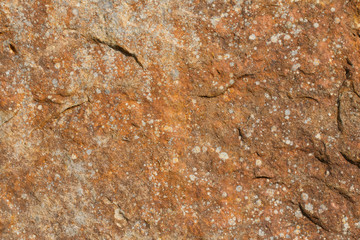 Rusty red rock face background