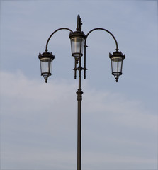 Silhouette of street lamp against background the sky.