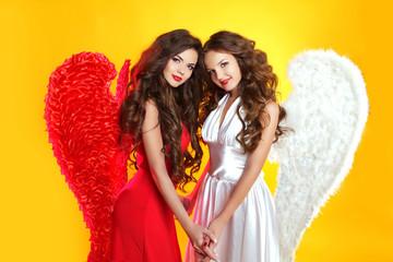 Beautiful Brunette Angel girls with angel's wings. Fashion women