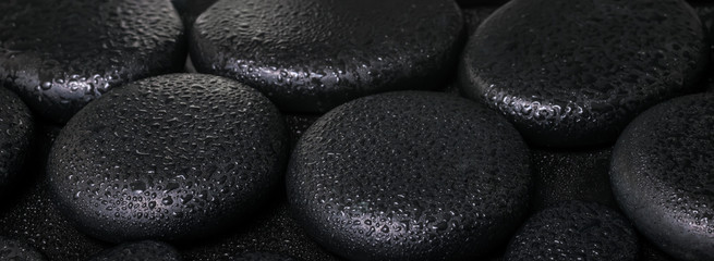 beautiful spa concept of zen basalt stones with dew, closeup