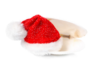 tropical concept of new year with red Santa Claus hats in shell