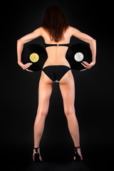 Shapely Woman DJ with two Vinyl Records.