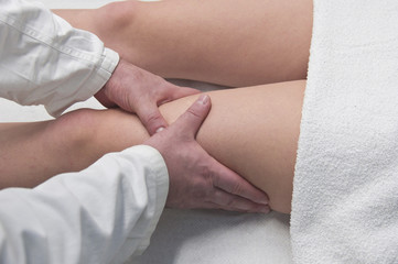 physical therapist, massages  the girl with hands